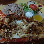 Grilled lobster with garlic sauce, rice & beans, side salad