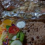 Grilled red snapper with garlic sauce, rice & beans, side salad