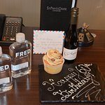 A nice touch from the hotel: birthday cupcake, wine, water and card