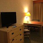 TV, dresser and desk.