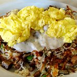 Sausage hash- hash browns, green peppers, onions, gravy, and 2 scrambled eggs Yummy