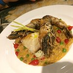 Sea bass with prawns, tiny sweet peppers from S. America