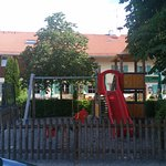 Перед отелем есть детская площадка. Ребенок оценил.