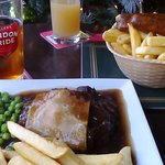 Steak and ale pie and sausage and chips.