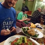 Vegan nachos foreground, vegan fish and chips far side.