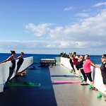 Practicing Pilates on the rooftop terrace.