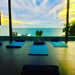 Spa room for practicing evening Pilates with the sunset.