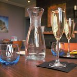 Crisp cold glass of prosecco in a comfy and welcoming environment
