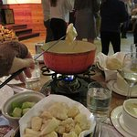 Fondue with bread and apples