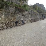 The children having fun walking in the bike racks at the entrance to Les Baux