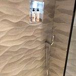Bathroom tiles look like waves, very tasteful.