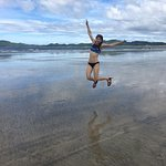 My happy 16 year old jumping for joy in front of Capital Suizo on the beach when the tide was ou