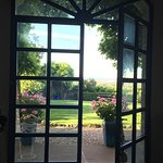 looking out dining room to back grounds