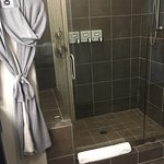 Large walk-in shower with courtesy bathrobes
