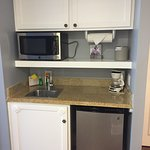 Mini kitchenette - included are plastic utensils, can opener, sponge, dish soap, mugs, plates et