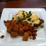 Carnitas Bennya Latin spin on eggs Benedict. Smoked cheddar-green chile biscuit s