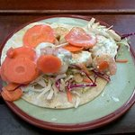 Shrimp a la plancha taco. Small. Tasty. Spicy aoili. Topped with carrot slices.