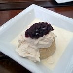 """Tres leches cake, a classic """"three milk"""" cake, topped with whipped cr"""