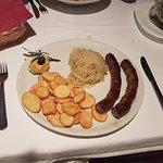 Homemade sausages with potatoes and sauerkraut