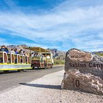 Welcome to Sabino Canyon sign as tram starts up Sabino Canyon Trail