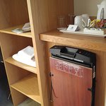 Wardrobe space, trouser press, courtesy tray