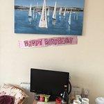 A picture of the tv and Jacqui's Happy Birthday welcome for Jo