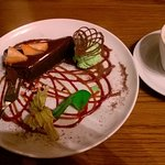 Chocolate tart with berry sauce and mint ice cream