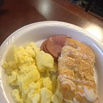 eggs, ham and pastry at breakfast buffet