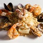 saffron scented risotto, prawns, scallops, calamari, crustacean fumé
