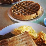 Pecan waffle, homemade sausage, eggs, toast and amazing home fries