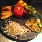 Indonesian vegetarian Mi Goreng noodle-stuffed peppers, mini Chinese spring rolls, Thai vegetabl