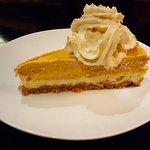 Pumpkin cheesecake with pumpkin whipped cream.