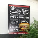 The irony of this sign! I sat in the drive close to an hour for a burger!