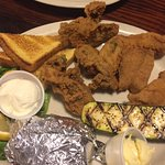 Local fried oysters and local caught fried red snapper, baked potato & fresh zucchini