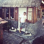 Nyoman and his big smile outside The Little Cottage