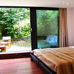 Deluxe Room glass wall can be fully opened, leaving you with your private garden.