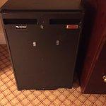 Very old and broken fridge in room