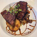 Newport Storm Braised Short Ribs with roasted parmesan potato rounds and root vegetables