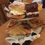 Sausage panini, scone with jam and cream and two slices of cake!