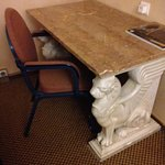 grand marble lobby style desk with a banquet chair? Curtains also didn't close completely