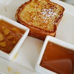 French toast with choice of banana rum or maple syrup