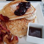 Huge pancakes with jam and syrup