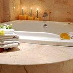 Take a relaxing bath at Condo 203