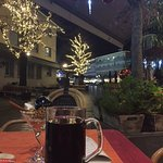 Drinking glühwein outside the hotel's bar, looking at the Christmas market