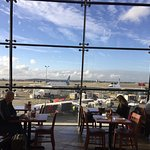 The meal, the interior of the restaurant and the view of the airport planes at the gate.
