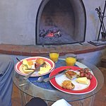 Breakfast by the kiva fireplace in the dining room.