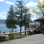 View of two bedroom lakeside cottage (A) and lake front