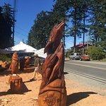 Chainsaw Wood Carving display outside Crown & Anchor,  6120 Island Hwy W, Qualicum Beach, BC