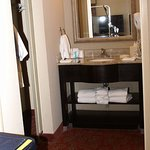 Sink and closet with full length sliding glass mirror, plenty of towels and high quality toiletr