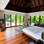 The bedroom with access to the garden/ pool/ beach
